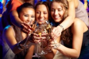 13301706-group-of-partying-girls-clinking-flutes-with-sparkling-wine